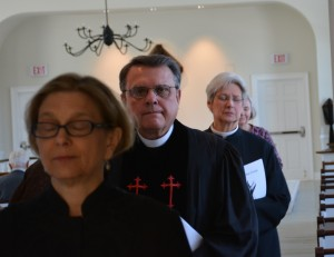 The ministers depart in solemn silence: Rev. Deborah T. Breault,  First Congregational Chuch of Blue Hill;The Rev. Doug Drown, First Baptist Church of Blue Hill; and The Rev. Claudia Wyatt Smith of St. Francis by the Sea, Blue Hill.